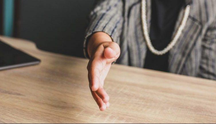 Woman extending hand to shake